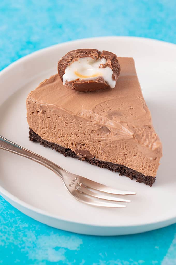 Top view of a slice of chocolate Creme Egg cheesecake with a Creme Egg on top