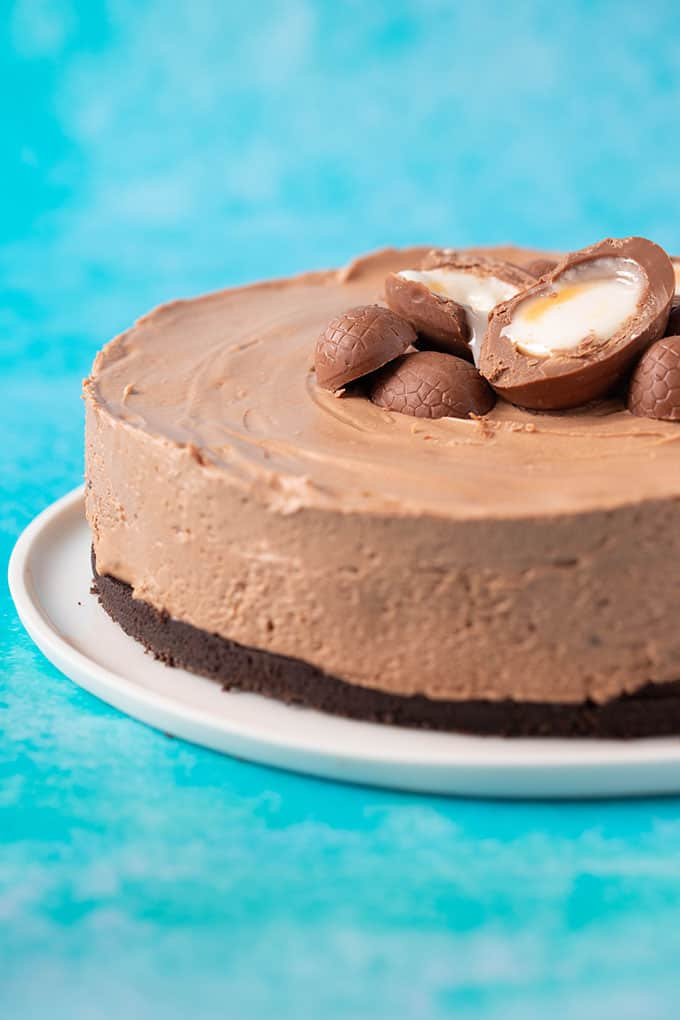 Close up of a homemade Creme Egg Cheesecake covered in chocolate Easter eggs