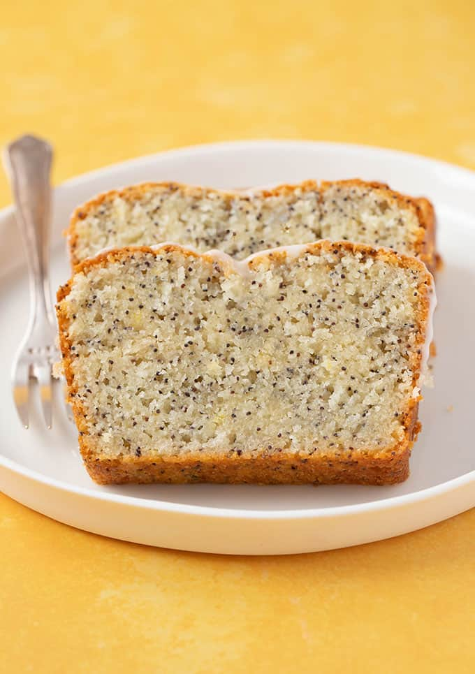 Thick cut slices of Lemon Poppy Seed Loaf on a white plate