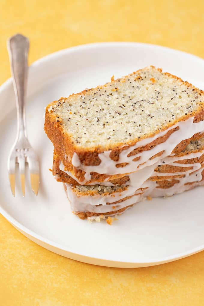 Close up of slice of Lemon Poppy Seed Bread on a white bread