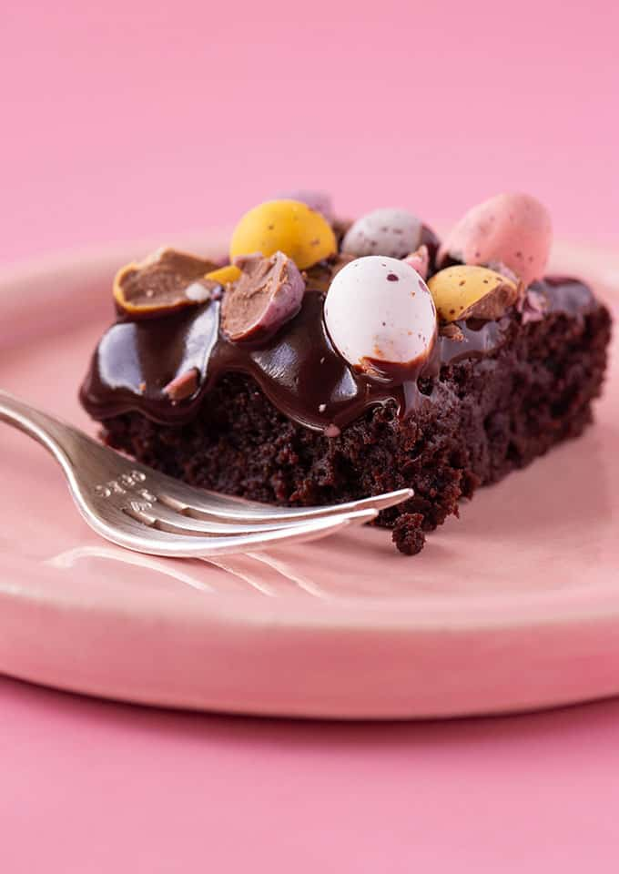 Close up of a fudgy Mini Egg Brownie on a pink plate
