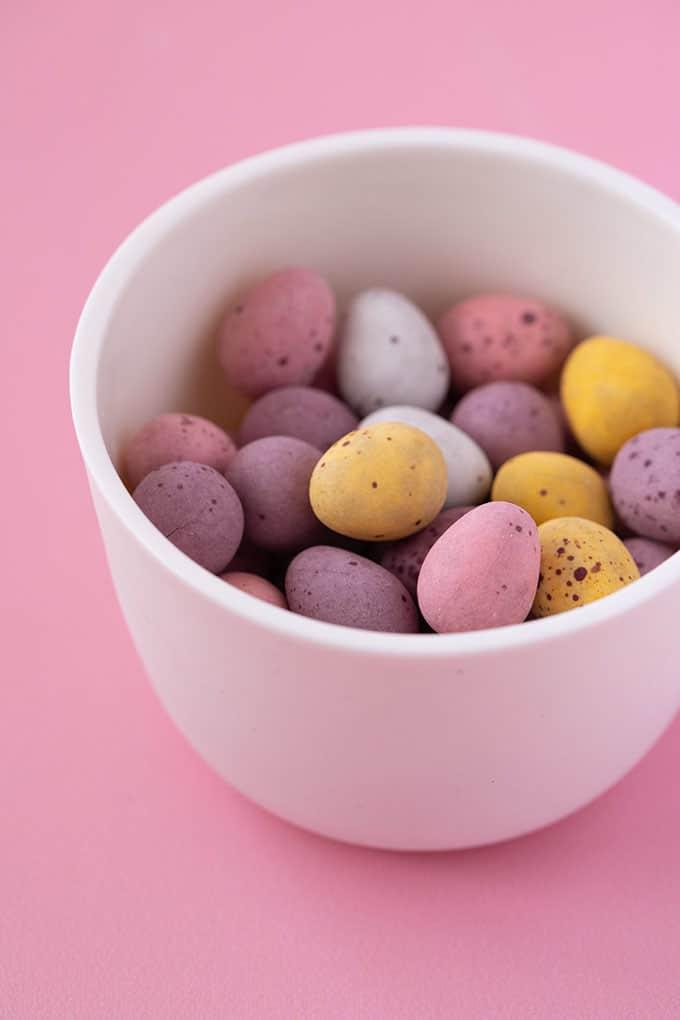 A white bowl filled with Cadbury Mini Eggs
