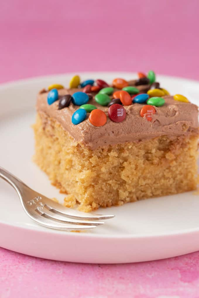 A slice of Peanut Butter Sheet Cake topped with M&M's