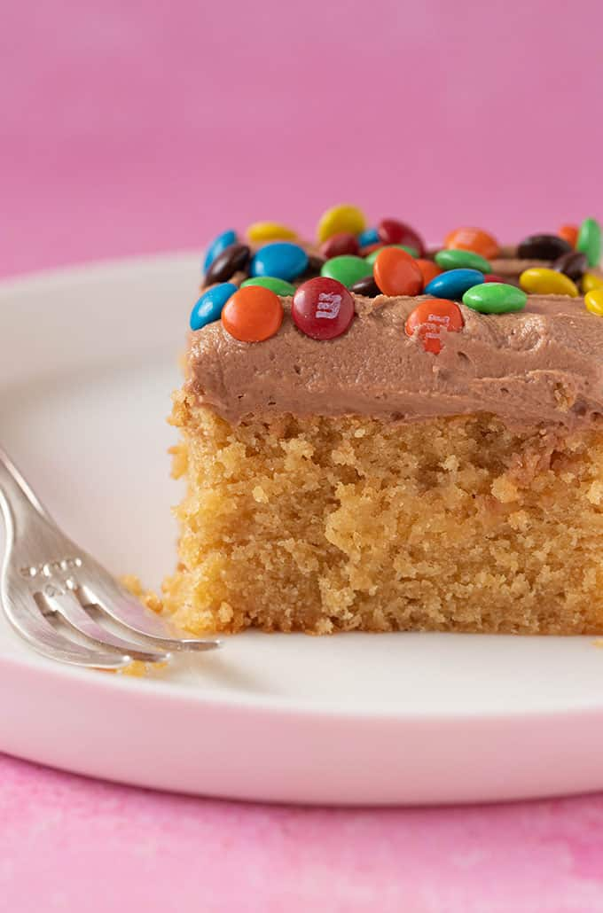 Close up of a slice of Peanut Butter Sheet Cake covered in chocolate frosting