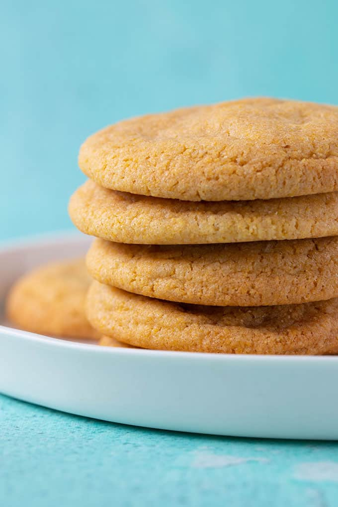 A stack of homemade Corn Cookies on a blue background