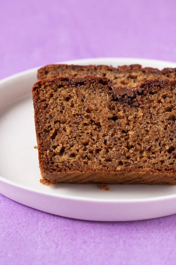 Close up of a slice of homemade Nutella Banana Bread on a purple background