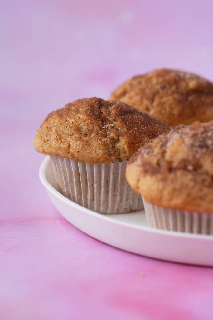 Close up of a homemade Cinnamon Donut Muffins on a white plate