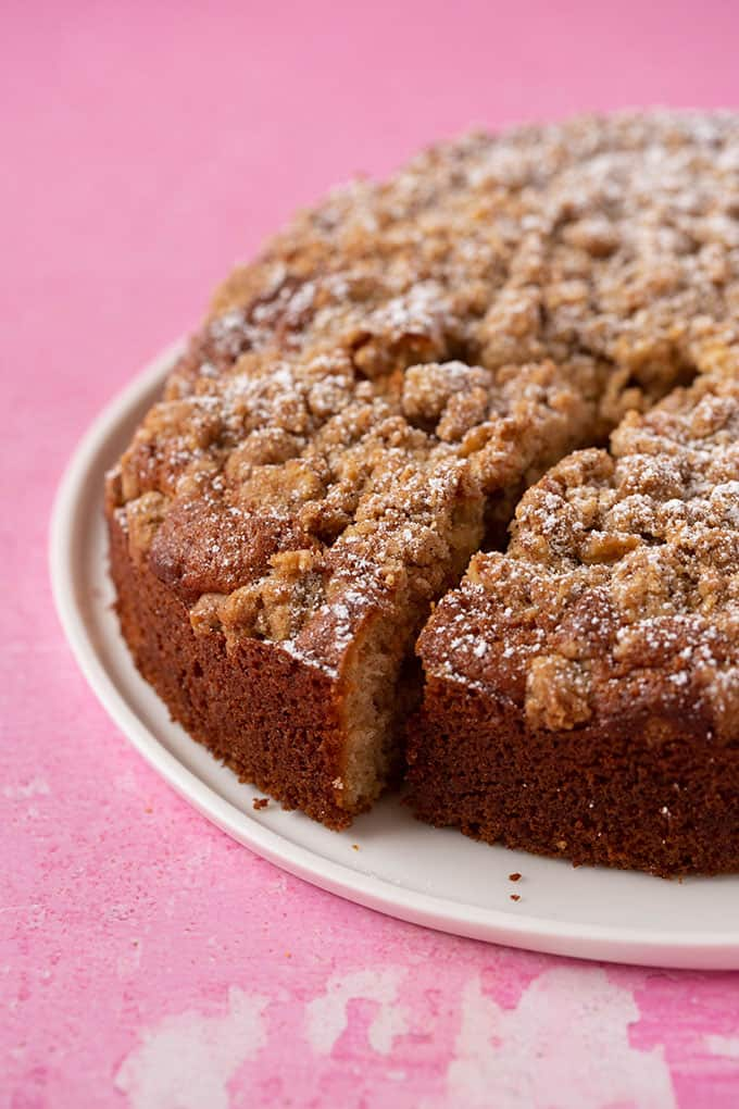 A homemade Coffee Cake with a slice taken out of it