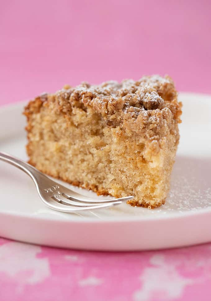 A slice of Coffee Cake on a white plate with a cake fork