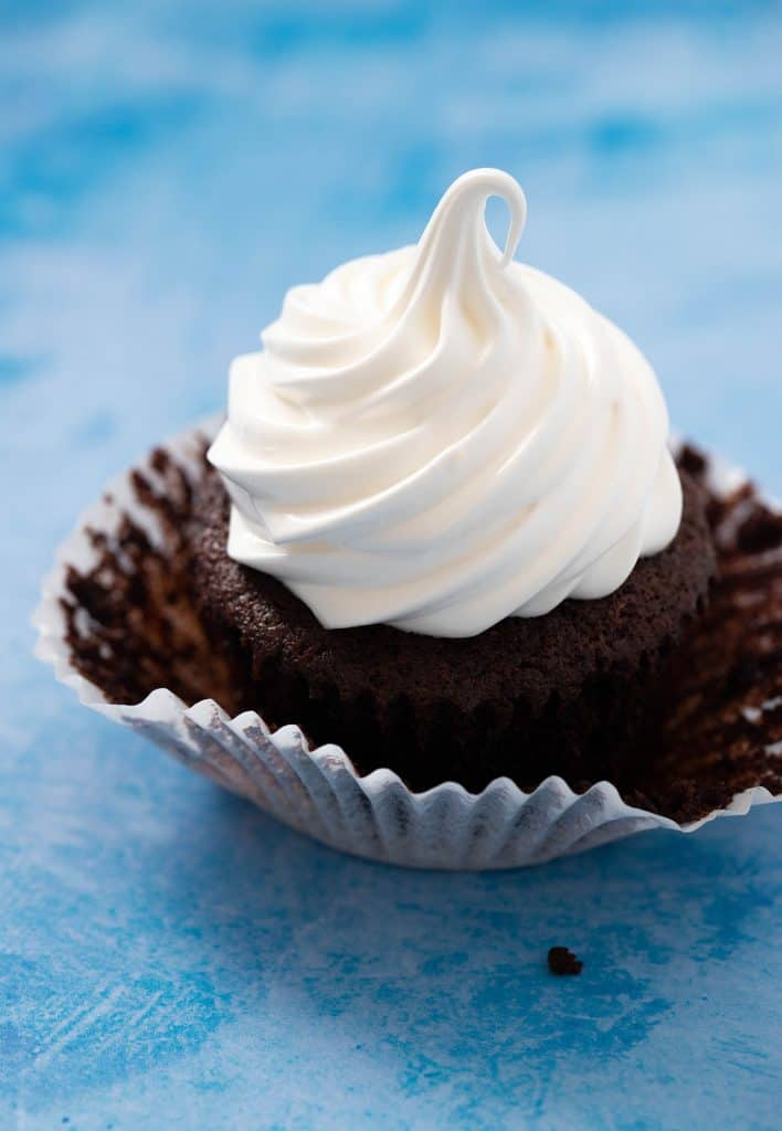 Close up of a Chocolate Cupcake topped up with homemade marshmallow fluff.