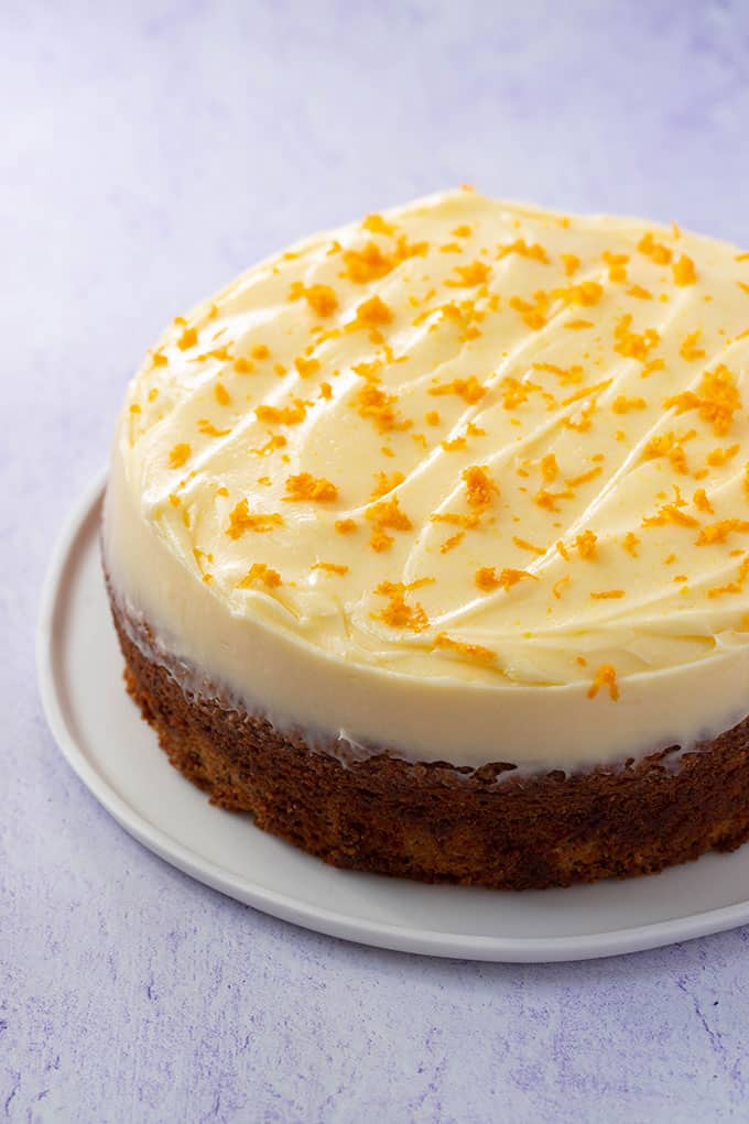 A one layer Orange and Poppy Seed Cake decorated with orange zest