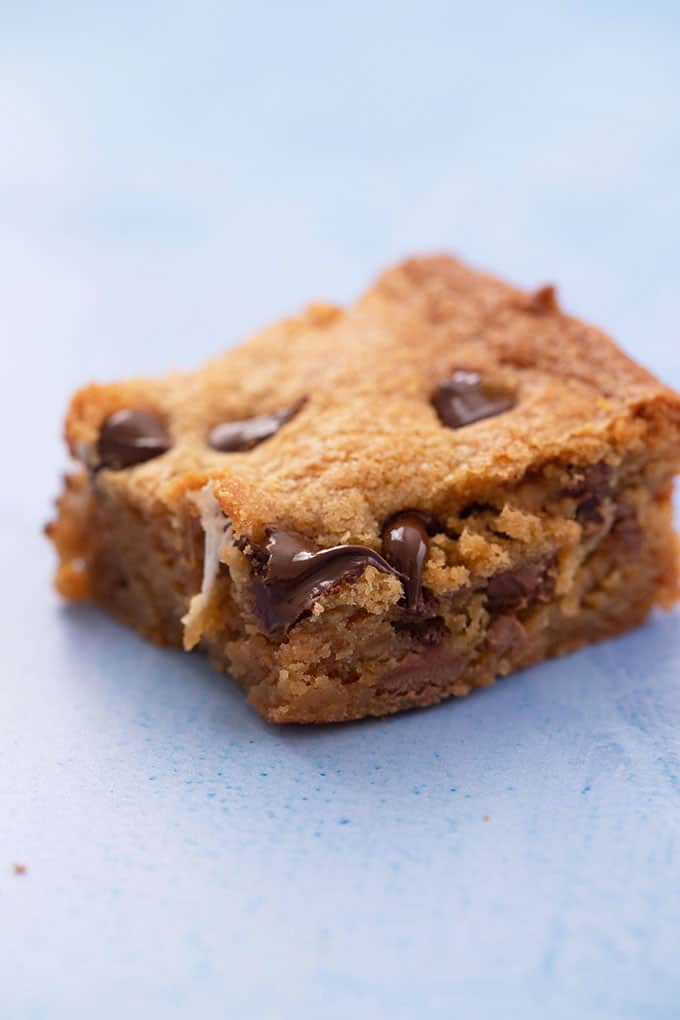 Close up of a Peanut Butter Blondie on a blue background