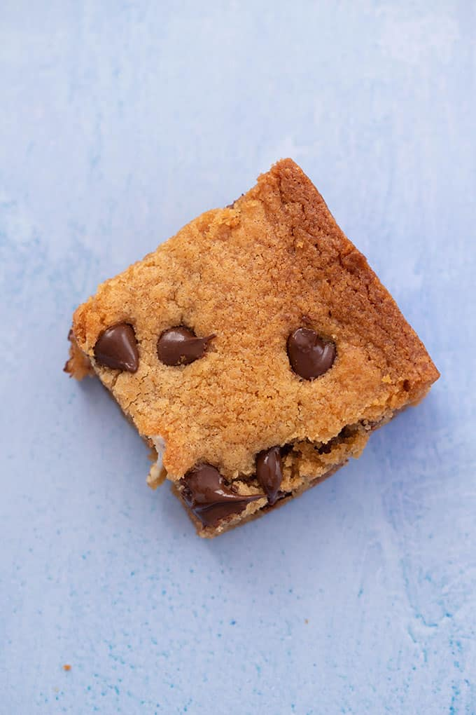 Top view of a Peanut Butter Blondie on a blue background