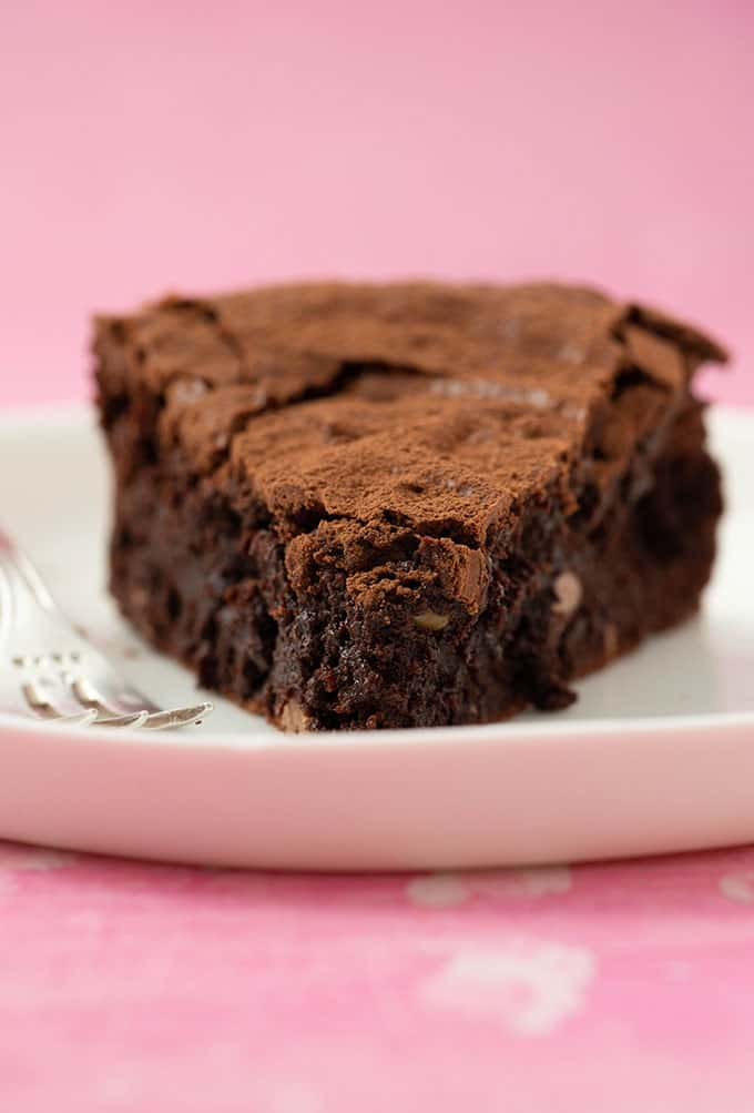 A close up view of a slice of Brownie Cake