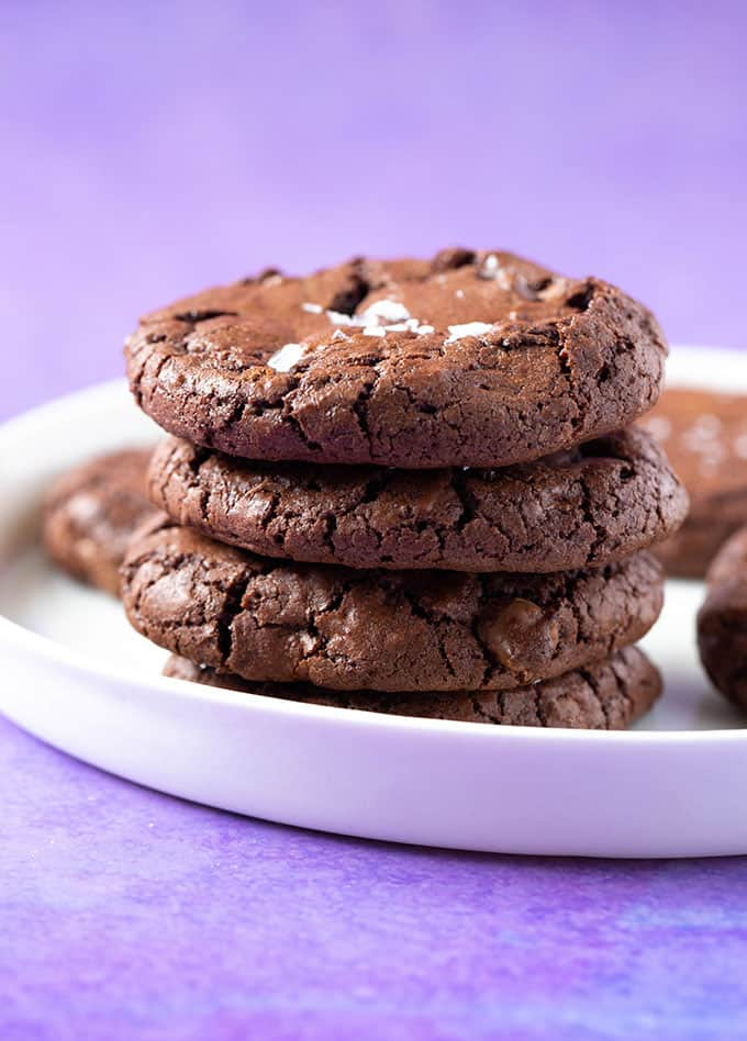 A stack of Chocolate Brownie Cookies on a white plate