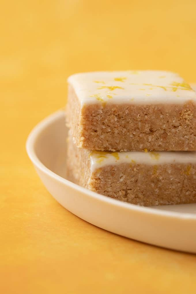 A stack of homemade Lemon Slice on a yellow background