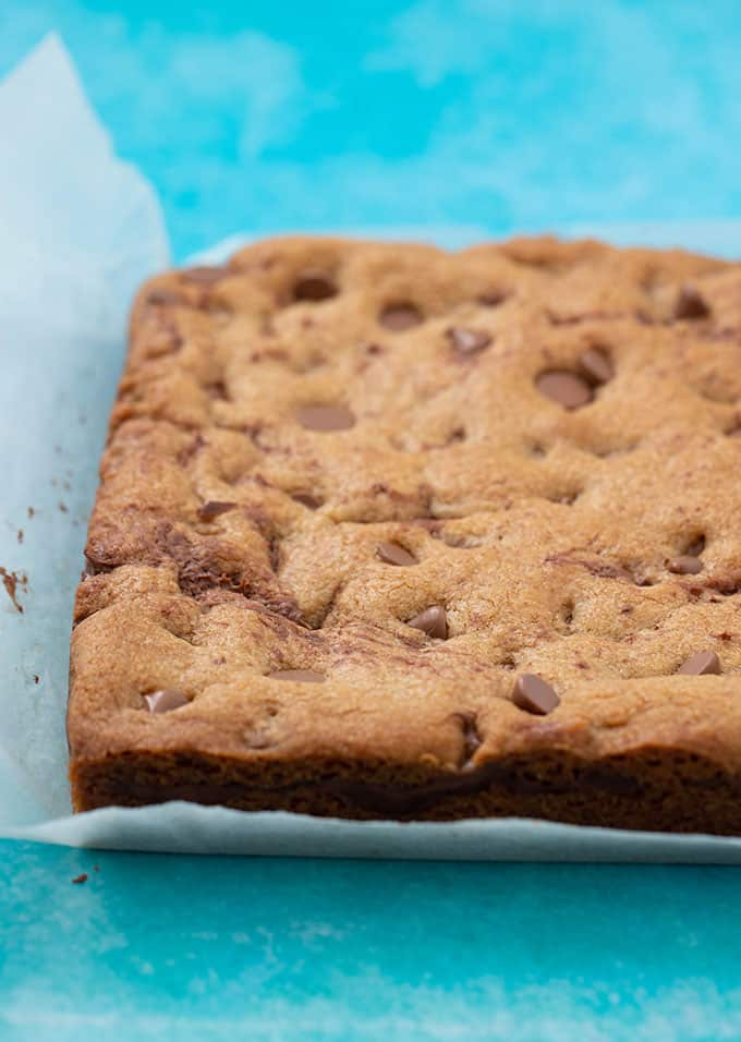 Fresh baked Nutella Stuffed Cookie Bars on a blue background