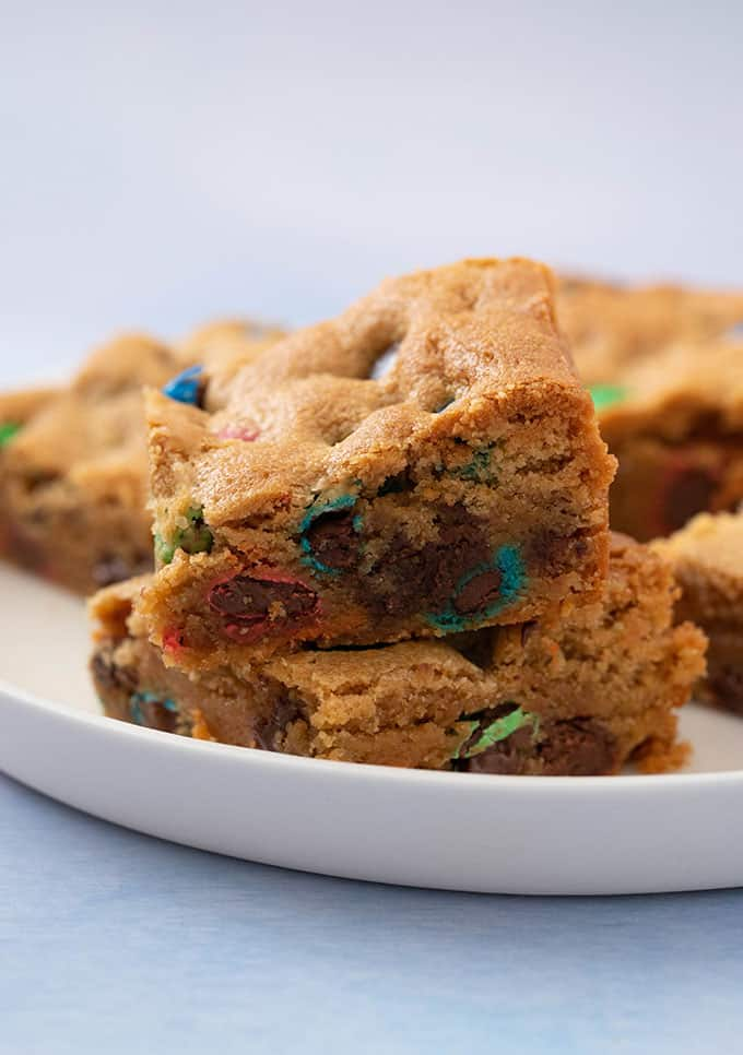 A stack of peanut butter bars with M&M's