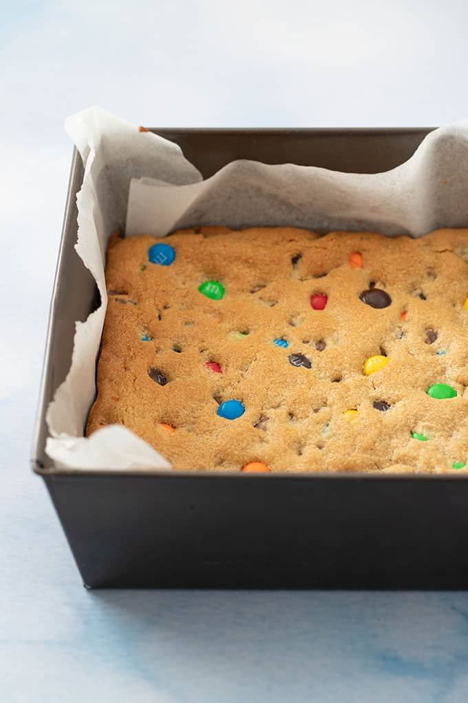 Homemade M&M Cookie Bar still in the oven pan