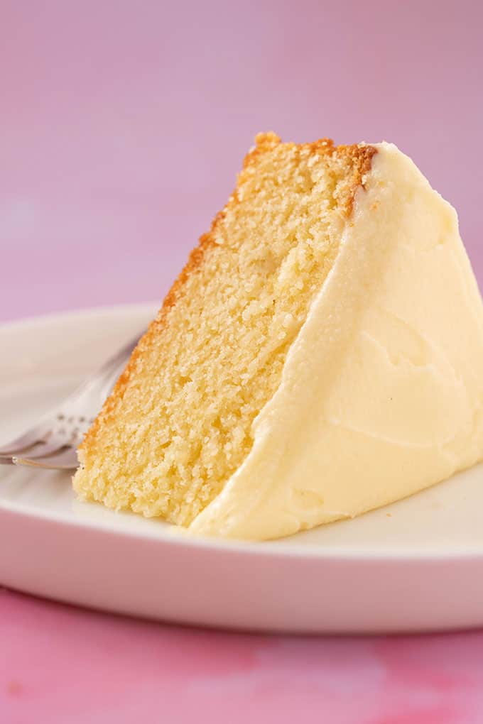 A close up shot of a slice of Sour Cream Cake on a white plate