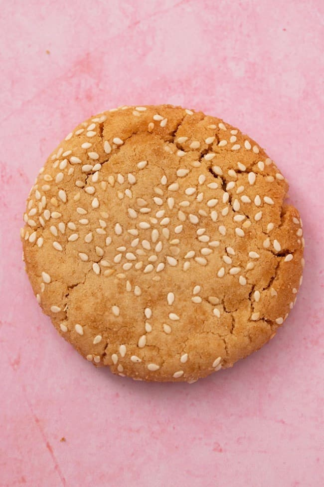 A tahini cookie on a pink background