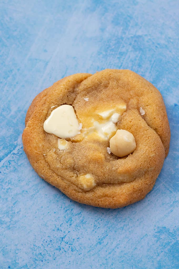 Close up of a homemade White Chocolate Macadamia Cookie sprinkled with sea salt