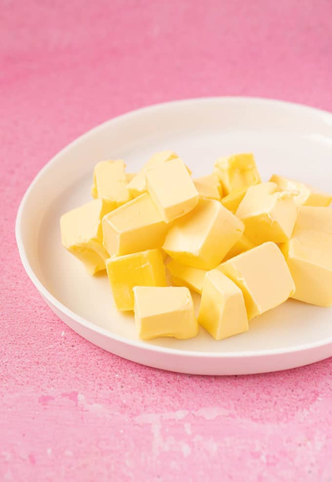 Chopped cubes of butter on a white plate