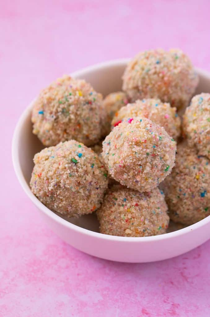 A white bowl filled with funfetti cake truffles
