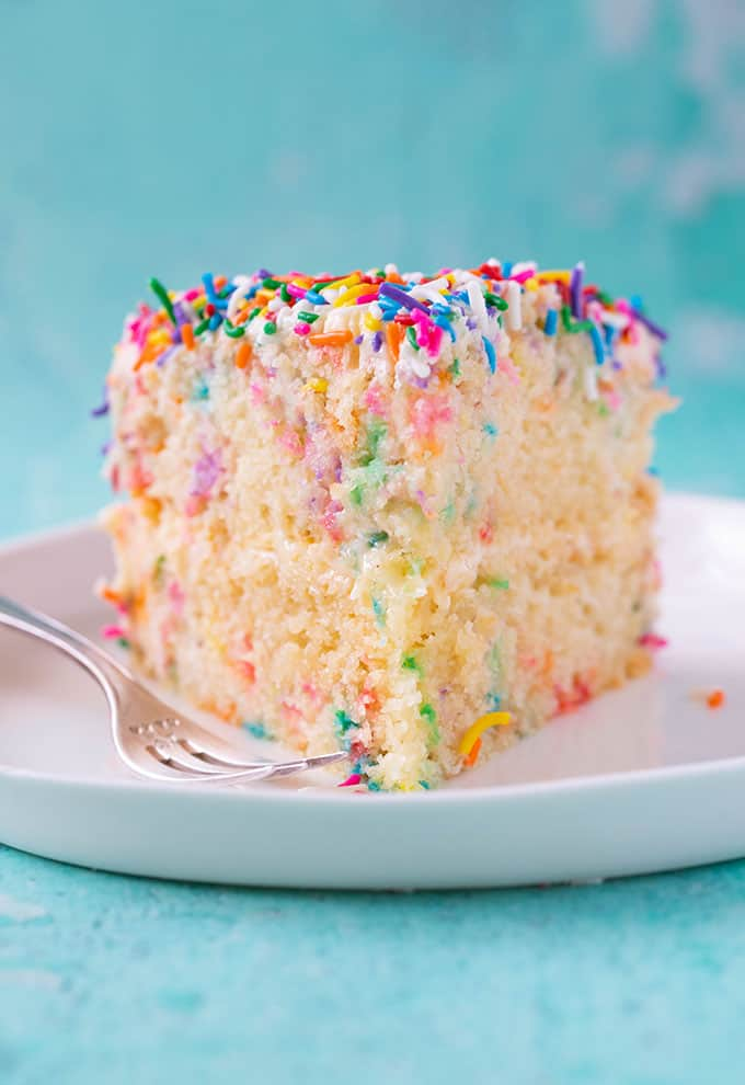 Front view of a slice of Funfetti Cake