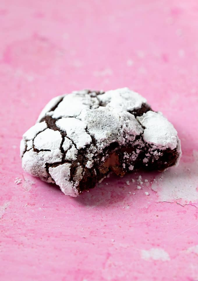 Close up of a Chocolate Crinkle Cookie with a bite taken out of it