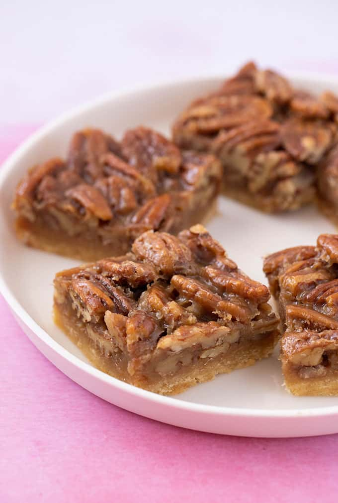 A white plate filled with Pecan Pie Bars