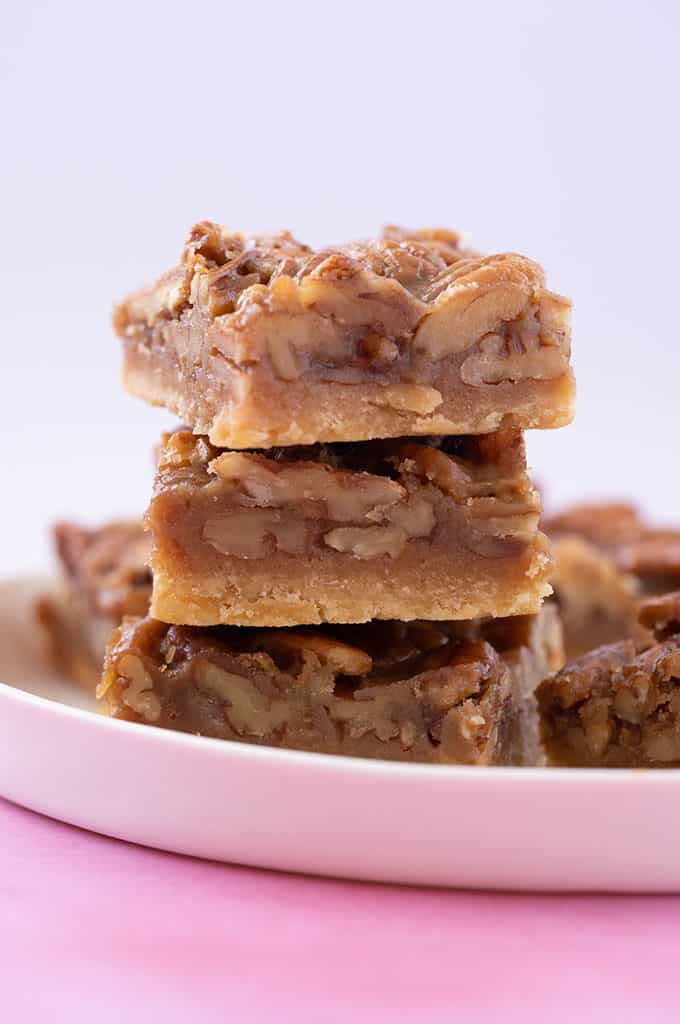 A stack of Pecan Pie Bars on a white plate