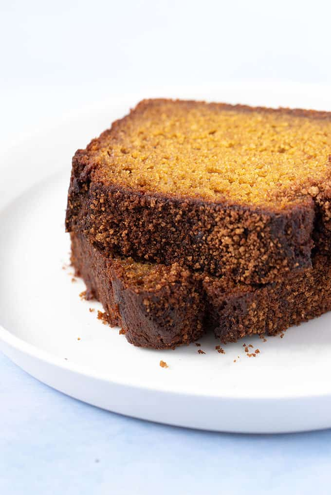 Close up of slices of Pumpkin Bread on a white plate