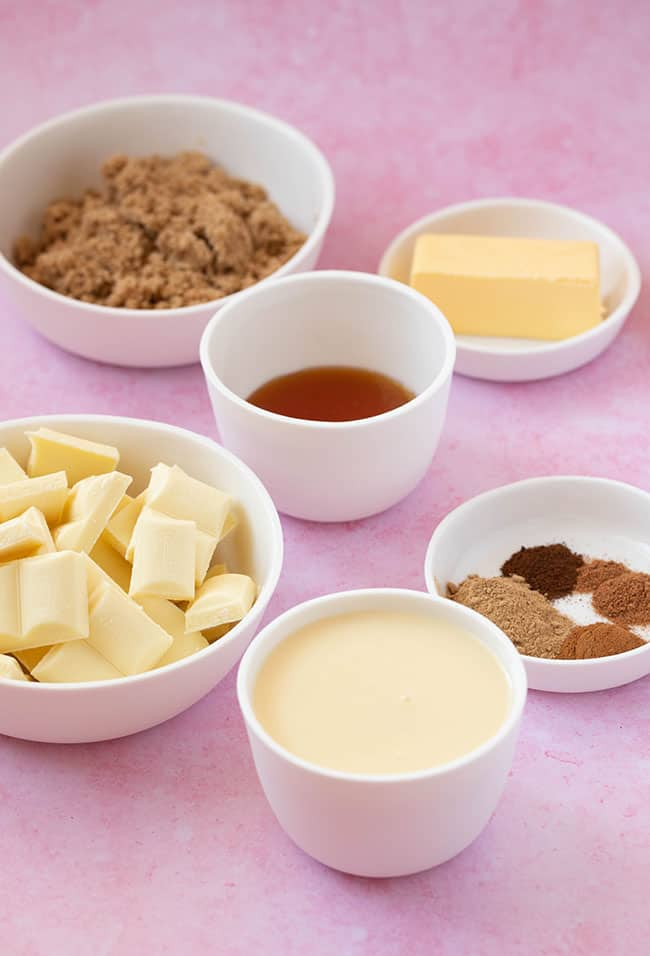 Ingredients for Gingerbread Fudge laid out on a pink background