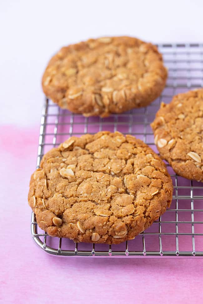 Anzac Biscuits sitting on a cooling rack