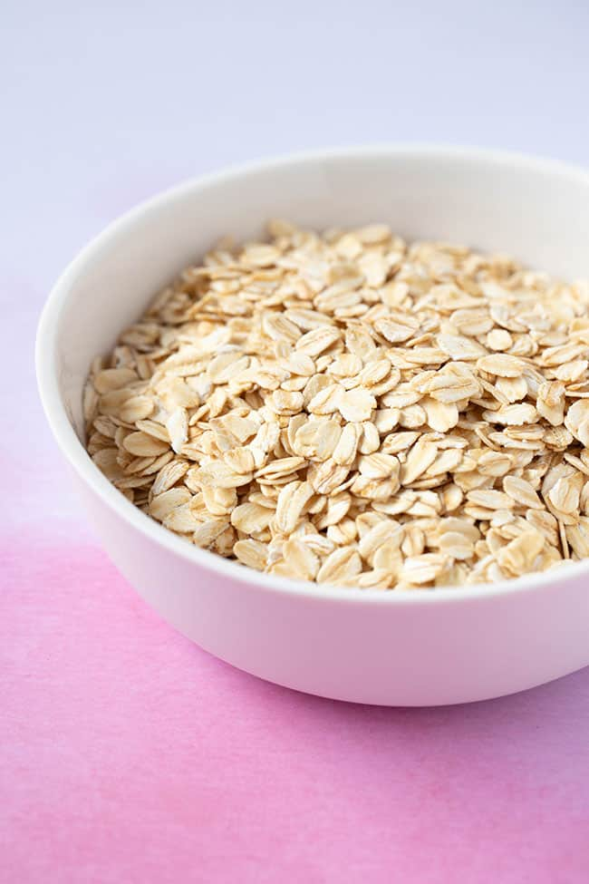 A white bowl filled with rolled oats