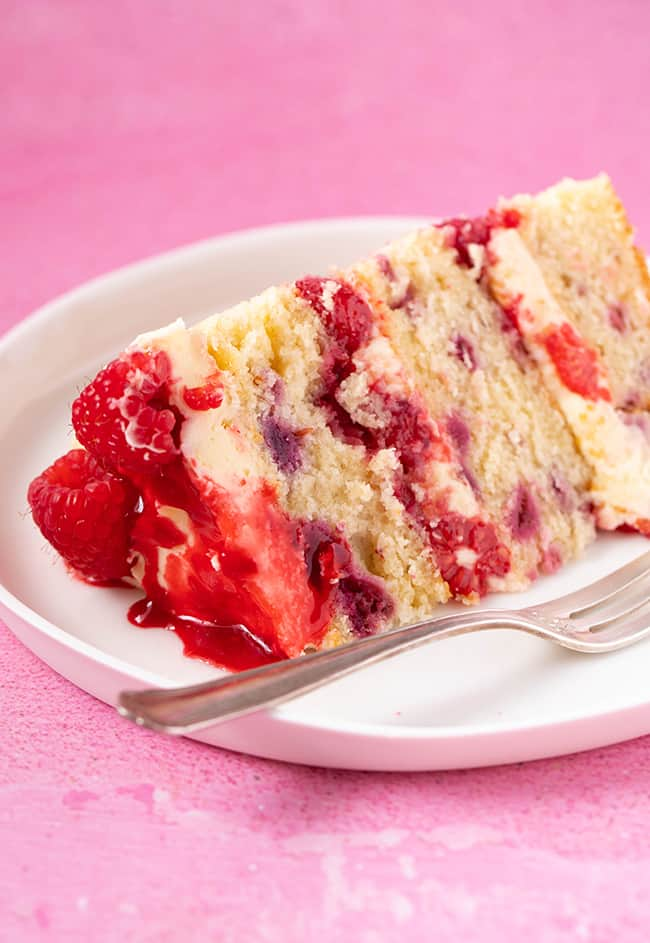 A slice of Raspberry Ripple Cake on a white plate
