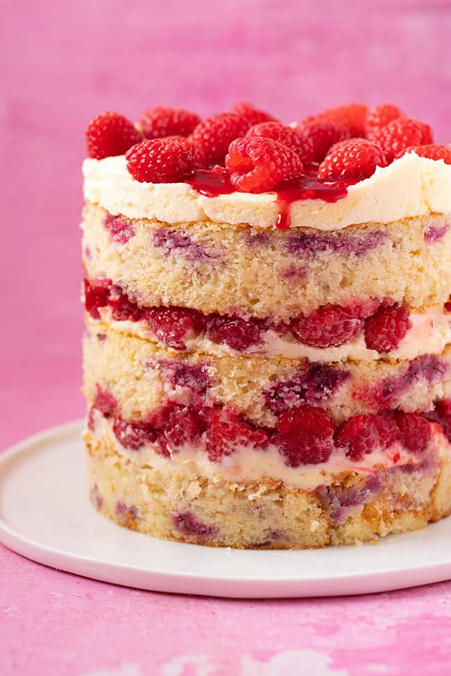 A beautiful Raspberry Layer Cake on a pink background