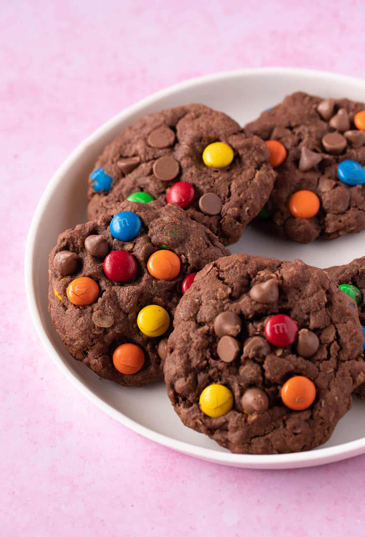 A white plate filled with homemade Chocolate Monster Cookies