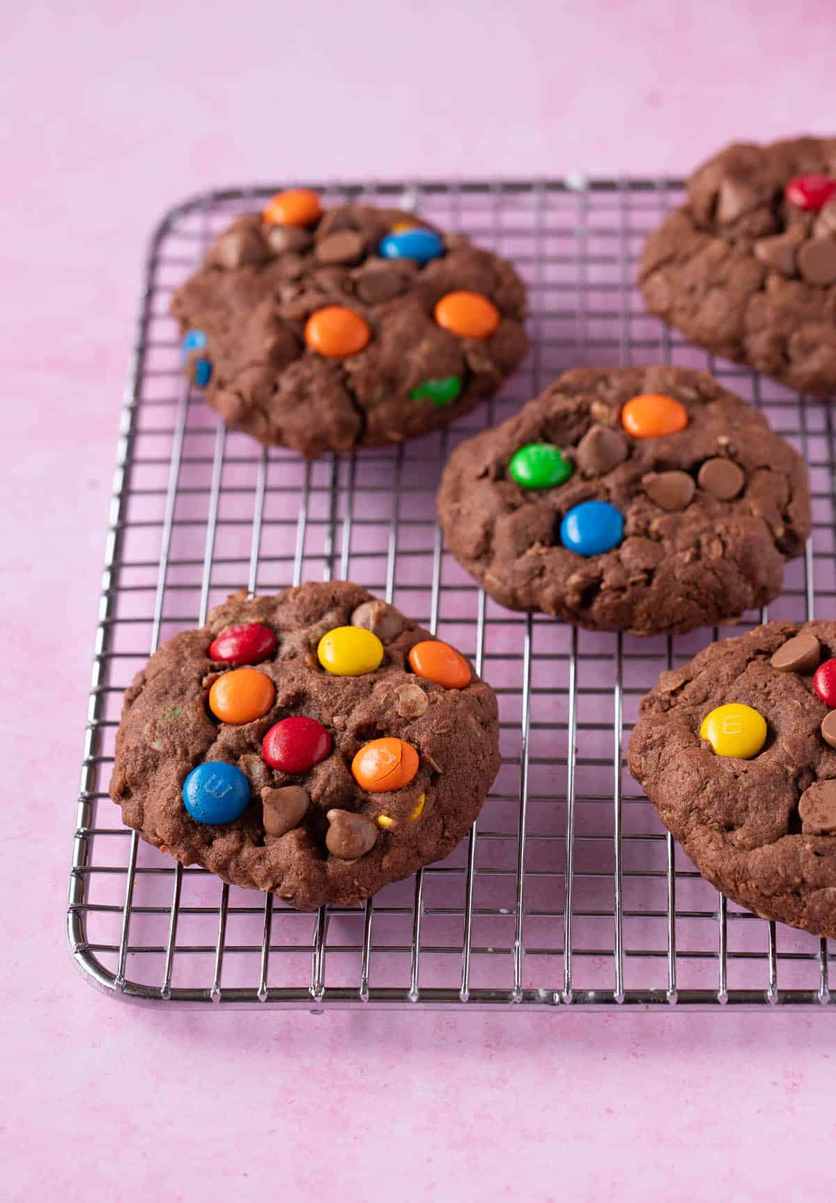 Chocolate Monster Cookies fresh out of the oven on a cooling rack