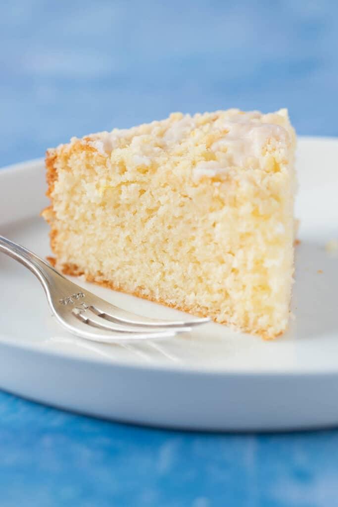 A slice of Lemon Yogurt Cake on a white plate