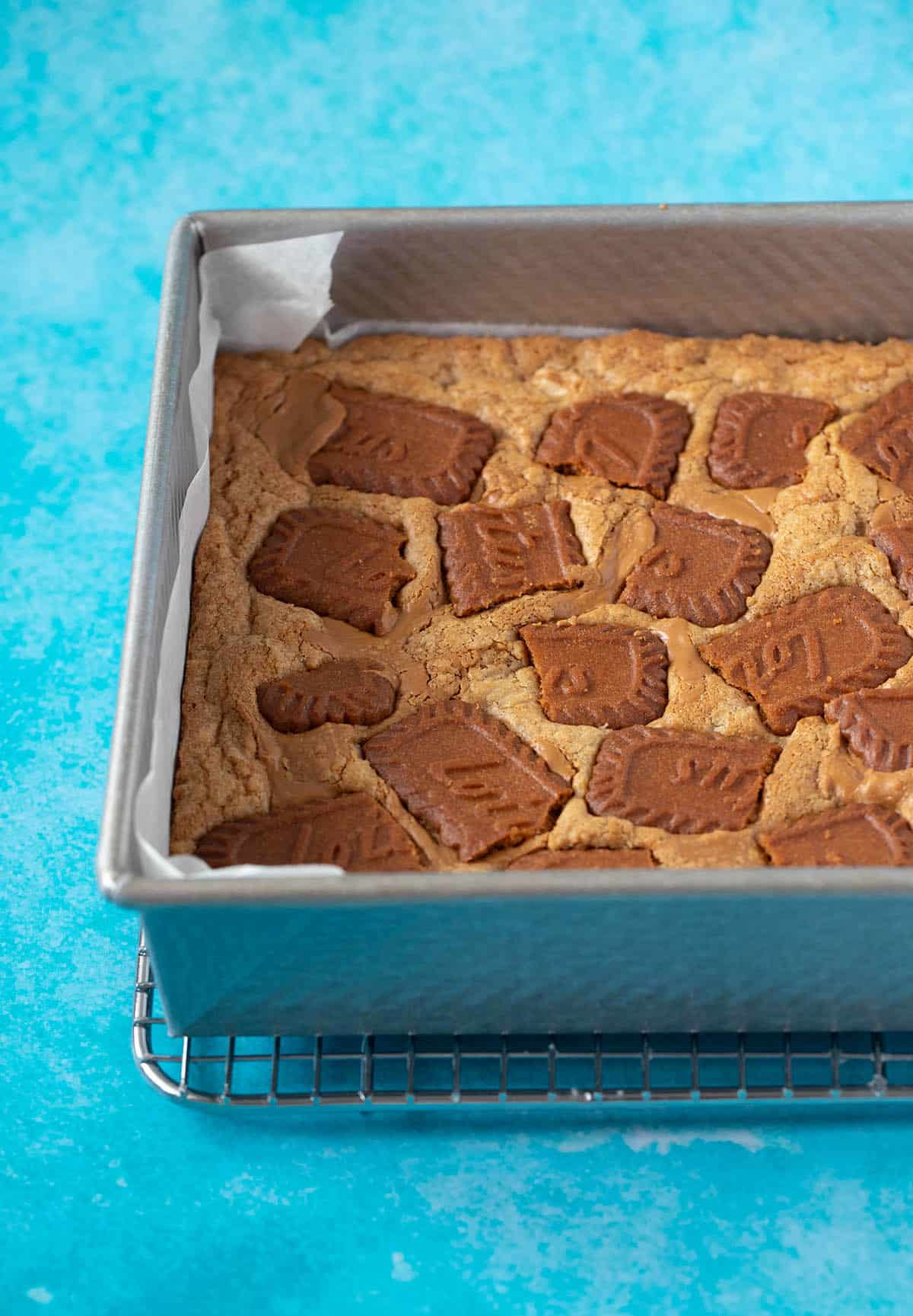 A blondies cooling in a baking pan after being taken out of the oven