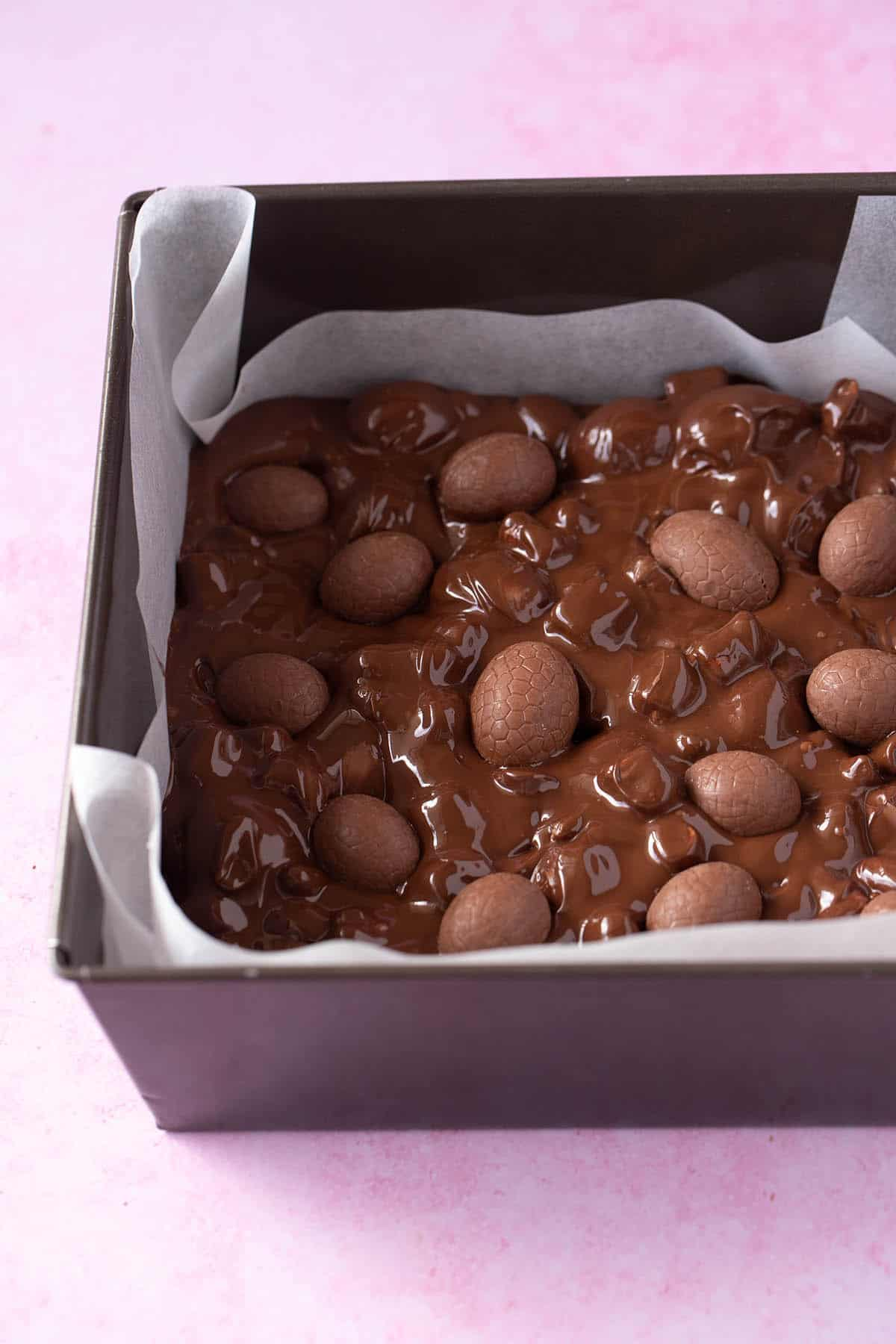 Easter Egg Rocky Road in a baking tin ready to set