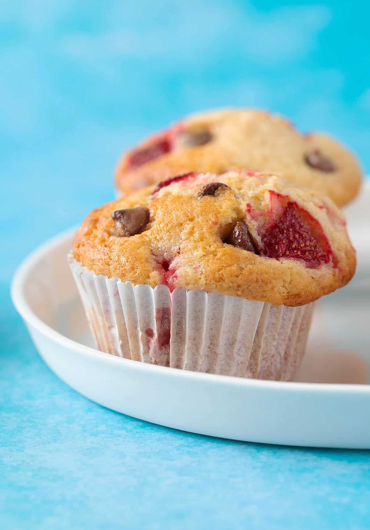 Close up of a freshly baked Strawberry Chocolate Chip Muffin.