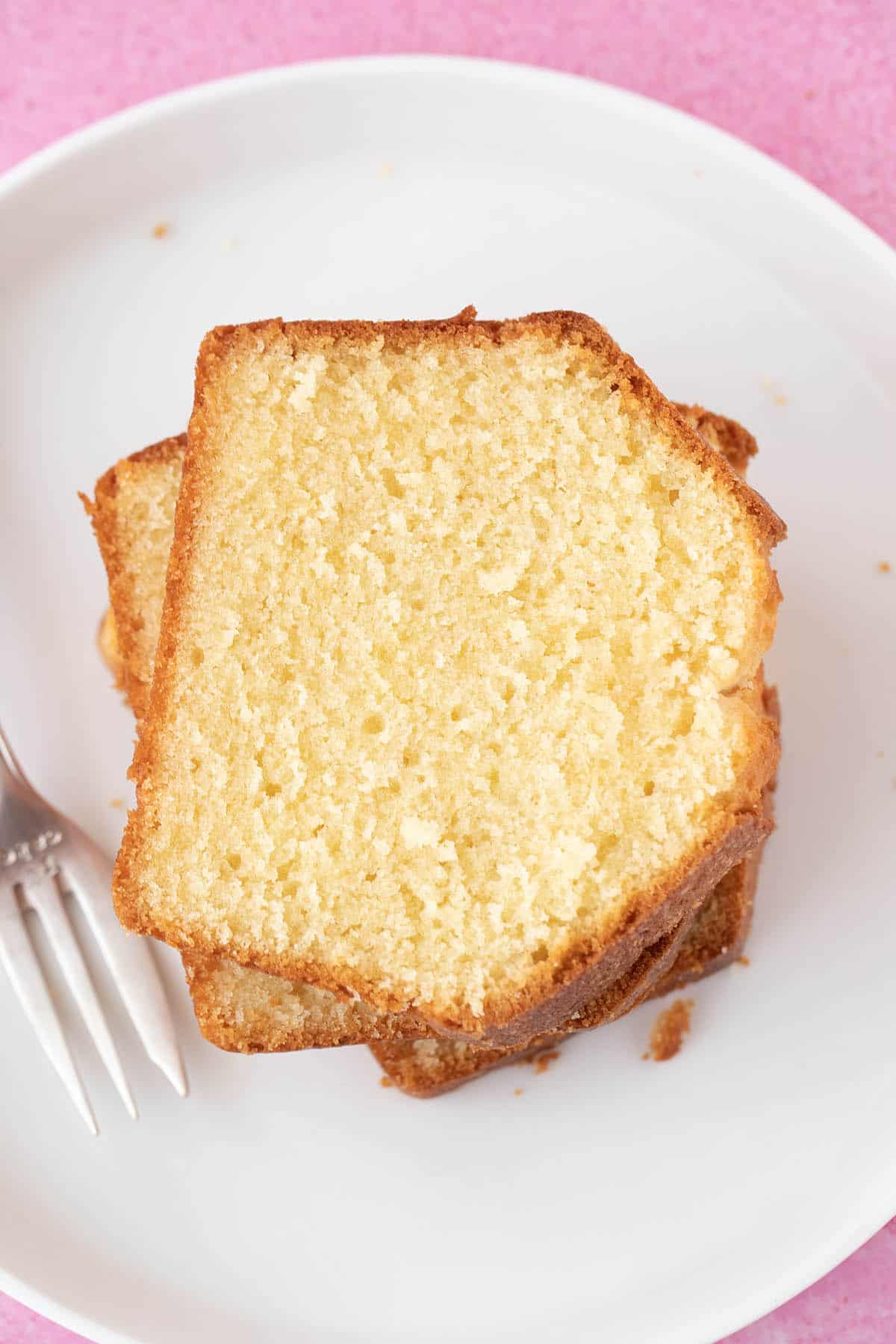 Top view of a slice of Pound Cake on a white plate