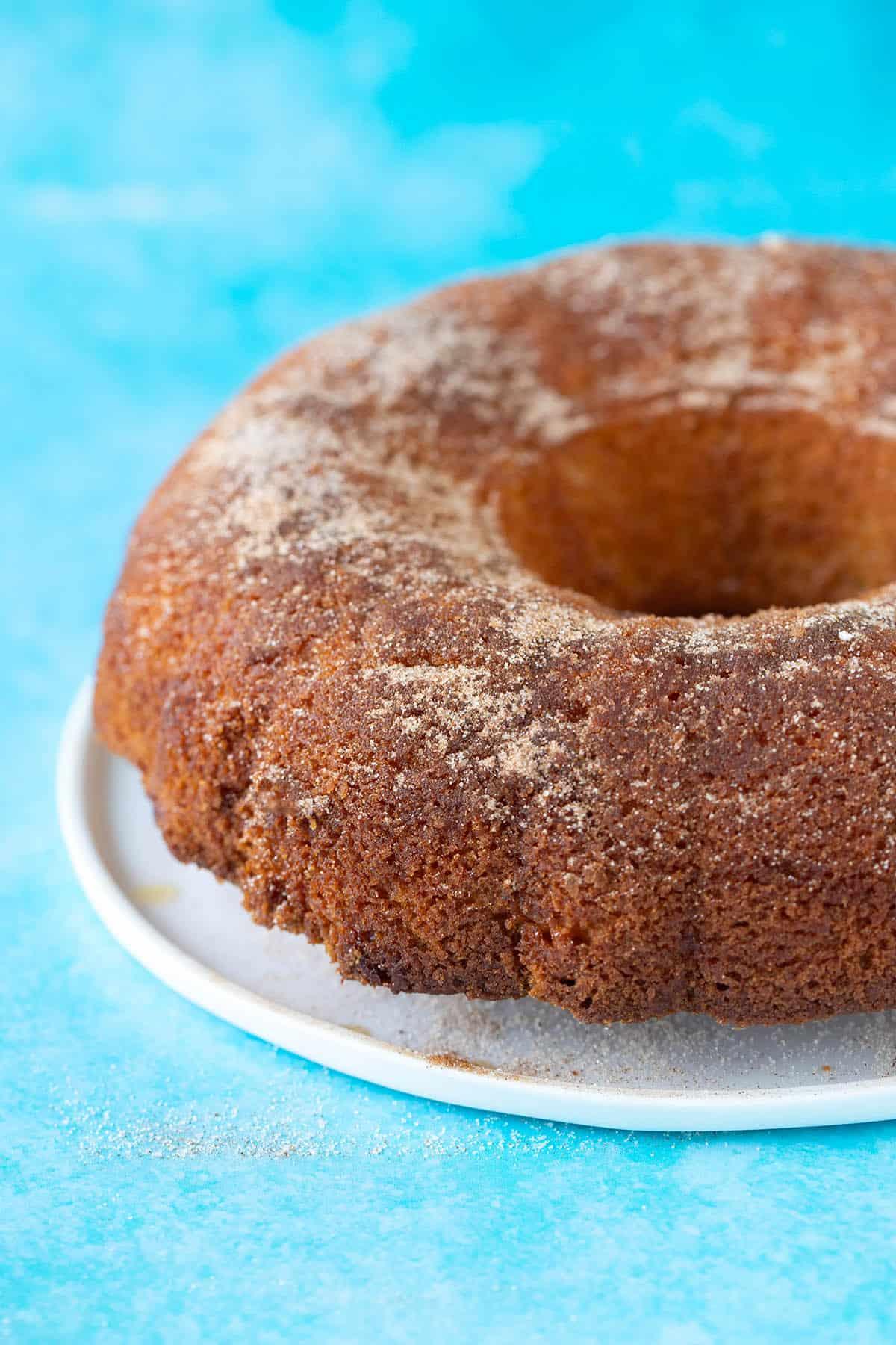A cinnamon Bundt cake on a blue background