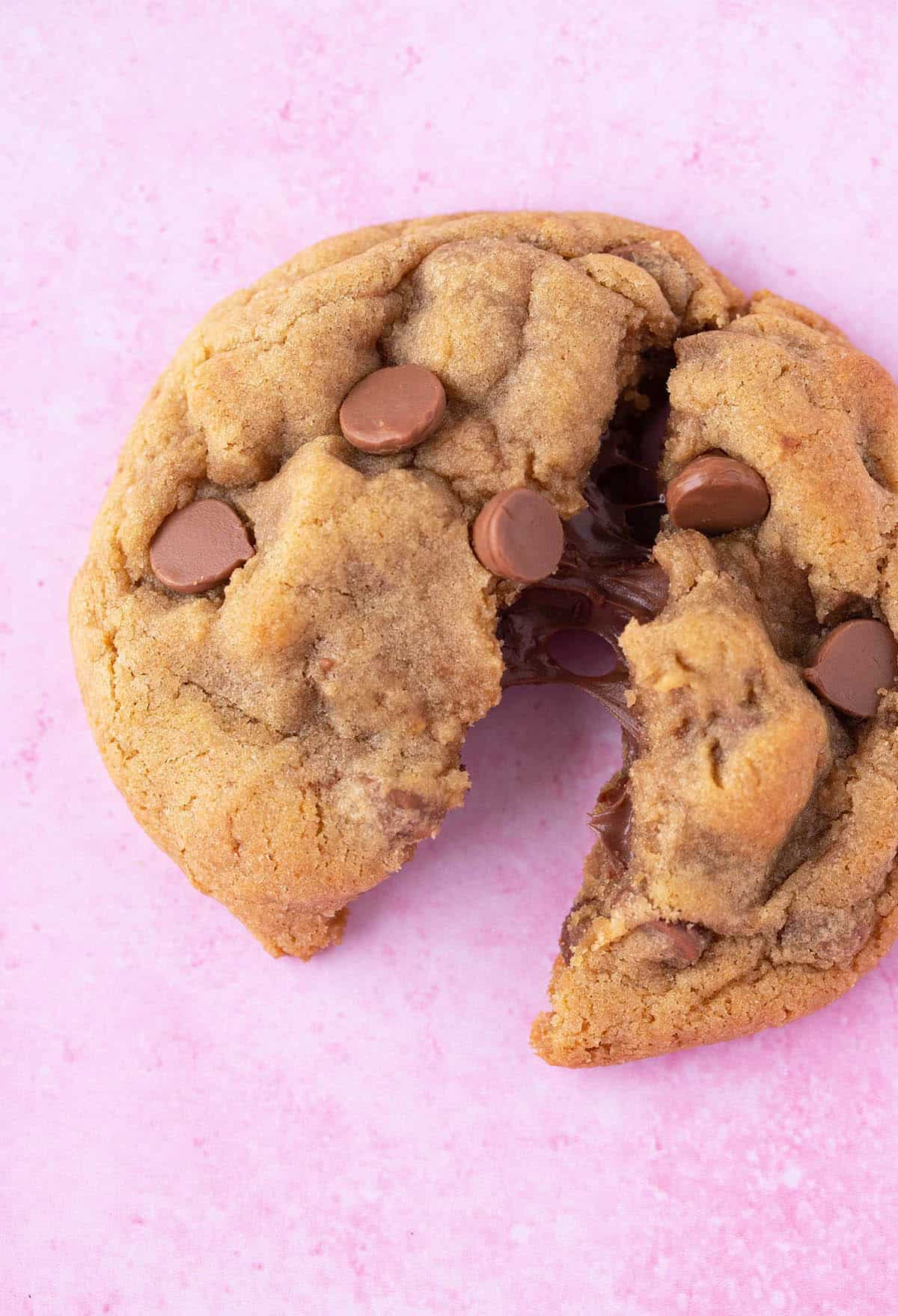 Close up of a Nutella Stuffed Cookie on a pink background