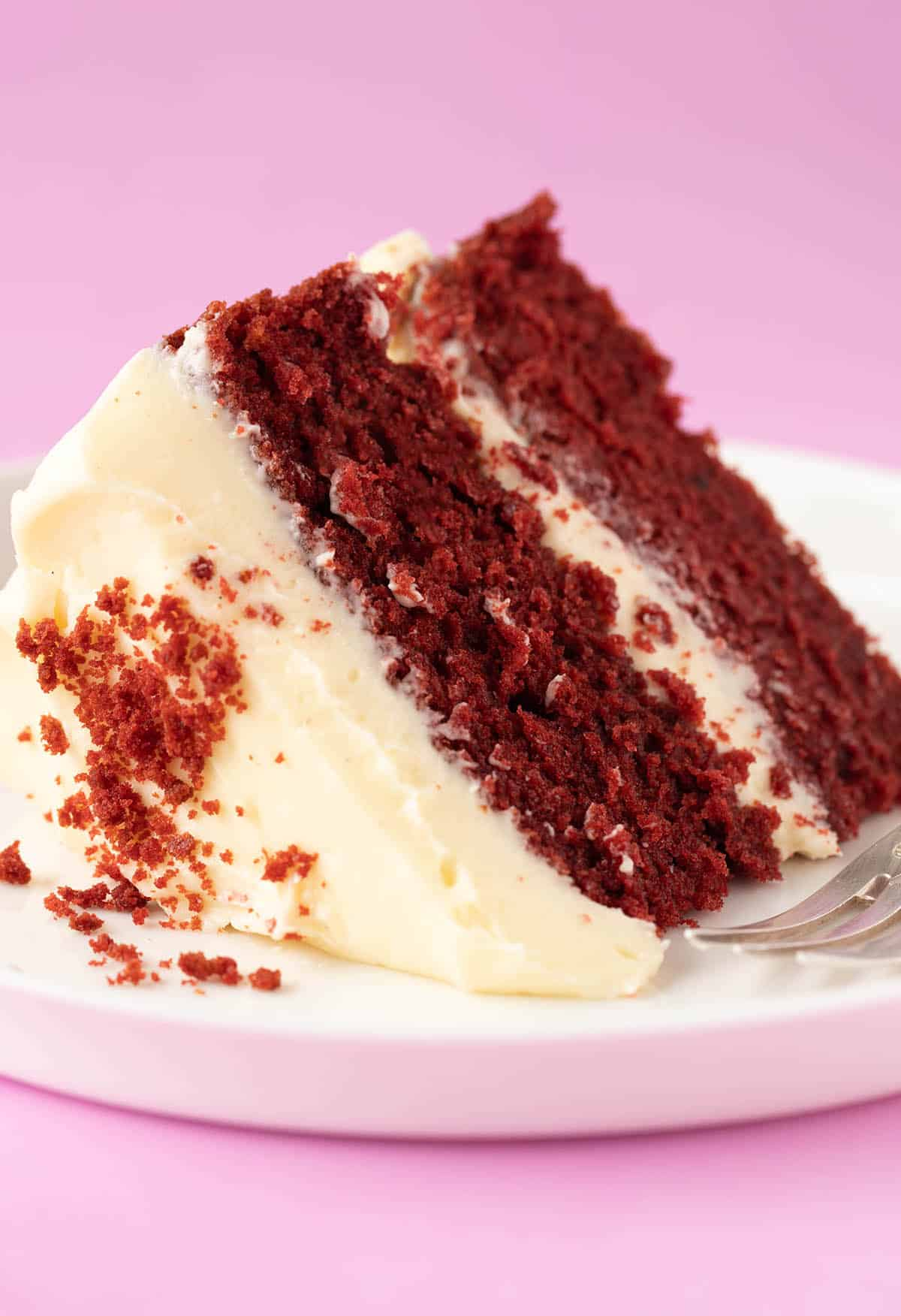 A close up of a piece of Red Velvet Cake with a sweet, buttery crumb