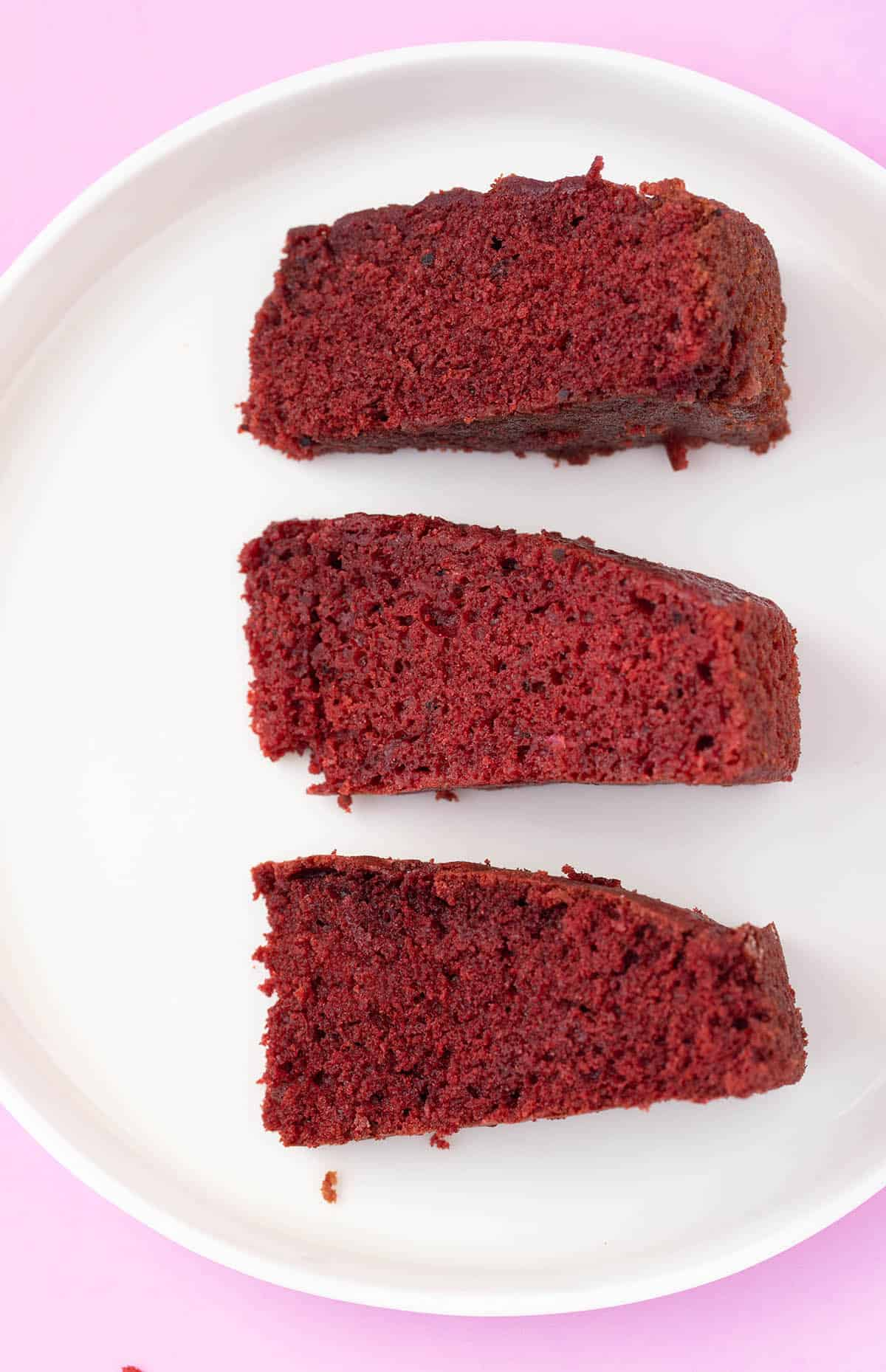 Top view of a white plate of different versions of Red Velvet Cake (recipe testing)