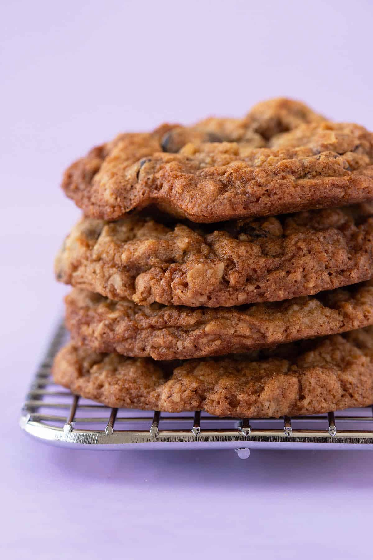 A stack of homemade Oatmeal Cookies on a purple background